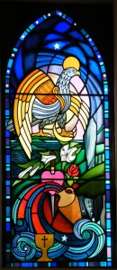 One of two stained glass windows, given to the church by a local artist.